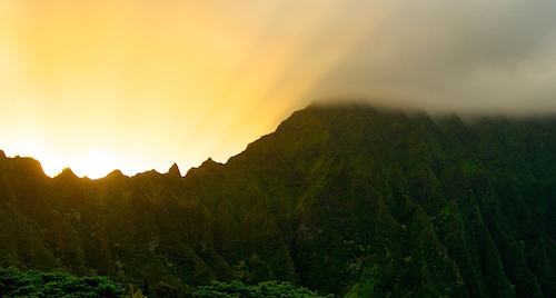Sunset over the Ko'olau mountain range from Kane'ohe, HI.